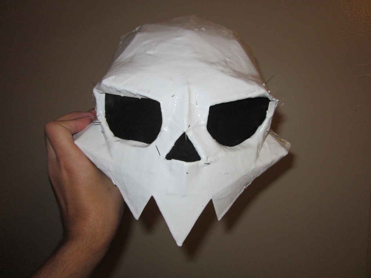 Those pins poke out of the front of the mask.
